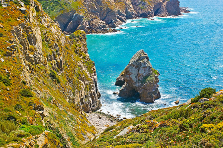 Cabo da Roca is the extreme point of Europe, famous among the tourists for its scenic landscapes, tiny hidden beaches and bright blue clear waters of Atlantic Ocean, Sintra, Portugal.