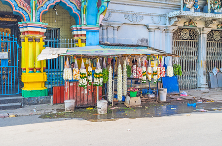 COLOMBO, SRI LANKA - DECEMBER 7, 2016: The flower garlands are important for the Hindus, so the stalls with such goods are located next to the Kovils, Sea street of Pettah district, on December 7 in Colombo.