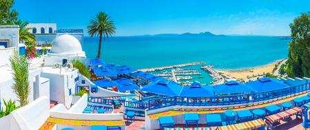 Sidi Bou Said boasts luxury restaurants and amazing viewpoints, overlooking its beaches, port and Cap Bon, seen on horizon, Tunisia.