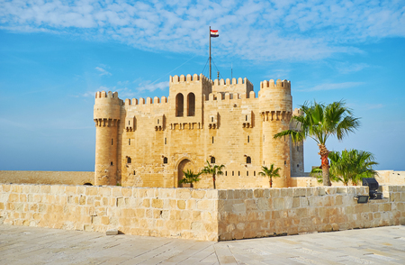 The view on Qaitbay castle from the tall defensive wall of fort, Alexandria, Egypt.