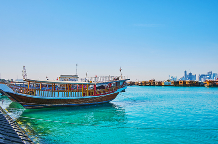 Traditional dhow boats are very popular in city, the tourist harbor is full of these wooden vessels, offering interesting trips along the coast, Doha, Qatar.