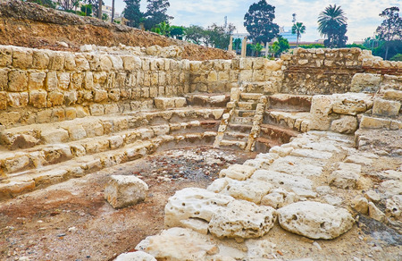The ruins of Roman Auditoria - the antique educational building (lecture hall) with preserved walls and stairs, Alexandria, Egypt.