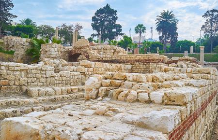 The ruins of antique school (lecture halls) in archaeological site of Kom El Dekka (Kom Ad Dikah), also famous as Roman Auditorium, Alexandria, Egypt.