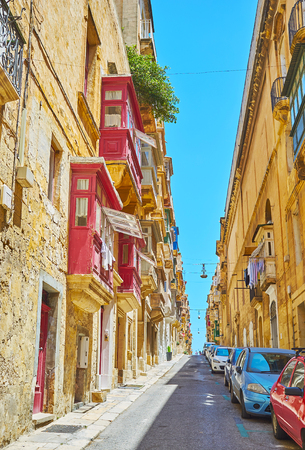 The old city streets stretch along its hilly relief, sometimes hard for long walking due to numerous ascents and descents, changing one another, St Ursula street, Valletta, Malta.
