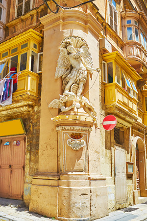 The masterpiece niche of St Michael the Archangel, vanquishing the devil, decorates the corner of Archbishop and St Ursula streets in Valletta, Malta.