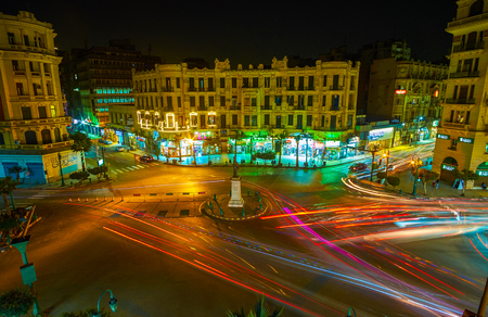 CAIRO, EGYPT - DECEMBER 23, 2017: The night view of noisy Talaat Harb square in European business district with fast traffic and brightly illuminated mansions, on December 23 in Cairo.