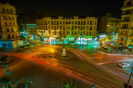 CAIRO, EGYPT - DECEMBER 23, 2017: The fast moving cars in Tallat Harb square, that located in business district of the city, it boasts European architectural style, numerous stores and cafes, on December 23 in Cairo.