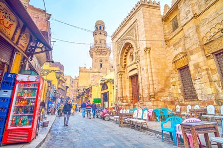 CAIRO, EGYPT - DECEMBER 20, 2017: El Gamaleya street is a fine example of real Egyptian life, with numerous medieval religion complexes, endless market and tea houses, stretch along the street, on December 20 in Cairo.