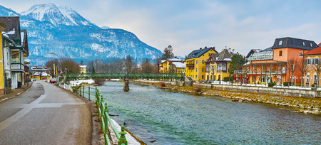 Photo for The cityscape with Traun river, Taubersteg pedestrian bridge and Mount Katrin on the background, Bad Ischl, Salzkammergut, Austria. - Royalty Free Image