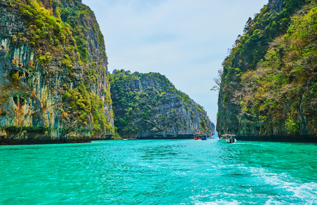 Photo for Enjoy the picturesque rocky landscape, floating along the Pileh Bay of Phi Phi Leh Island, Krabi, Thailand - Royalty Free Image