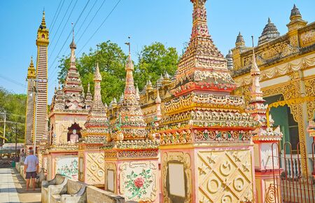 Photo for Extraordinary architectural design of Thanboddhay Pagoda with many funerary stupas, covered with fine stucco patterns in pastel colors, Monywa, Myanmar - Royalty Free Image