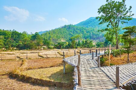 The bamboo bridges are popular constructions in farmlands of Thailand, Boon Ko Ku So bamboo bridge is one of such landmarks, located in Pai suburb