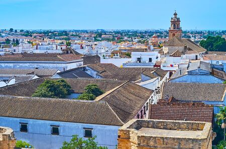 Foto de Aerial view of Bodegas Barbadillo winery roofs and bell tower of Our Lady of O church, rising over the city, Sanlucar, Spain - Imagen libre de derechos