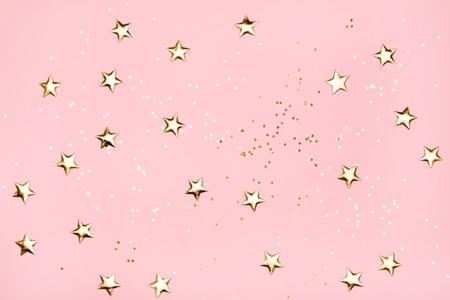Foto de Golden stars glitter on pink background. - Imagen libre de derechos