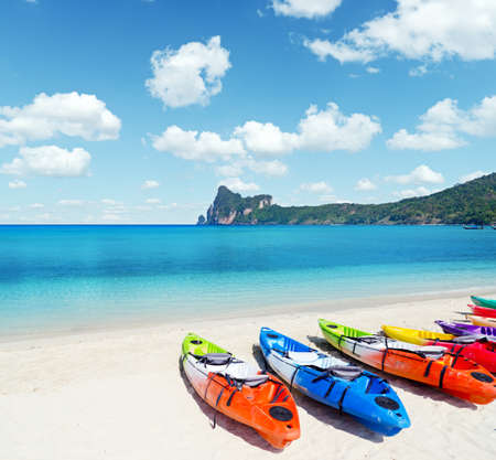 Photo for Colourful kayaks on tropical beach. - Royalty Free Image