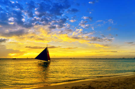 Sunset  landscape. Sailboat on coast of Boracay island.