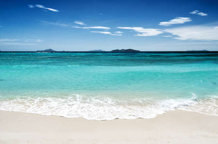 White sand beach and blue sky. Coron, Busuanga island, Palawan province, Philippines.