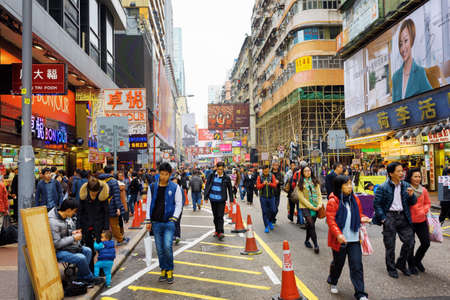 HONG KONG - FEBRUARY 1, 2015: Pedestrians on streets of city Hong Kong. Hong Kong is a popular tourist attraction of Asia and leading financial centre of the world.