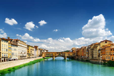Medieval bridge Ponte Vecchio (Old Bridge) and the Arno River in Florence, Tuscany, Italy. View from the Ponte Santa Trinita (Holy Trinity Bridge). Florence is a popular tourist destination of Europe.