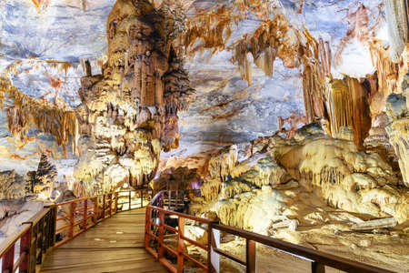 Scenic stalactites and stalagmites at amazing chamber inside Paradise Cave (Thien Duong Cave) at Phong Nha-Ke Bang National Park in Vietnam. Paradise Cave is a popular tourist attraction of Asia.