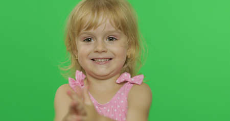 Photo for Pretty girl in pink swimsuit smiles. Portrait close up. Cute little blonde child, 3-4 years old. Summer vacation concept. Green screen. Chroma Key - Royalty Free Image