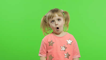 Photo for Positive girl emotionally make faces and smile in pink blouse with stars. Portrait close up. Happy, cute little blonde child, 4-5 years old. Green screen. Chroma Key - Royalty Free Image