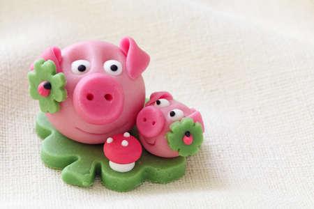 Marzipan pig with cloverleaf and mushroom