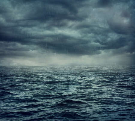 Rain over the stormy sea, abstract dark background