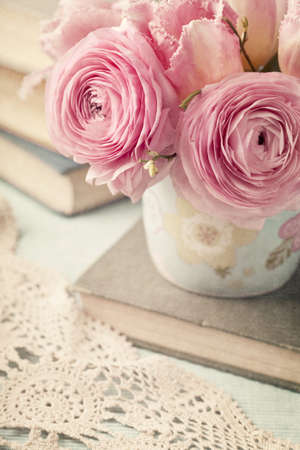 Pink flowers and old books