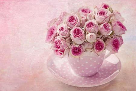 Pink vintage rose on pink background