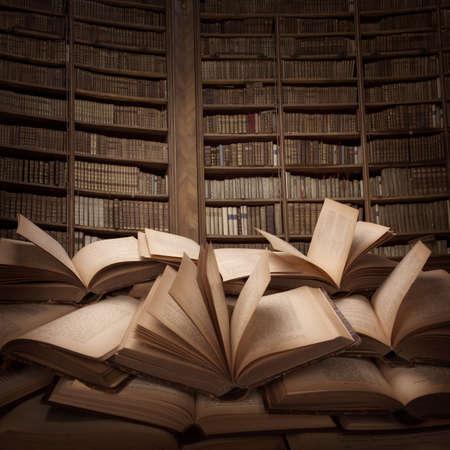 Photo pour Pile of open books on the table  - image libre de droit