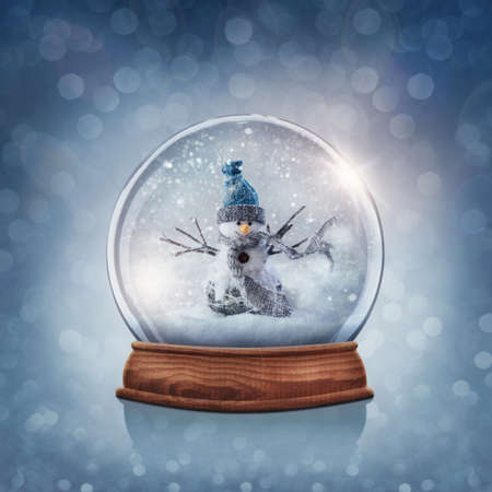 Snow globe with snowman on a blue background
