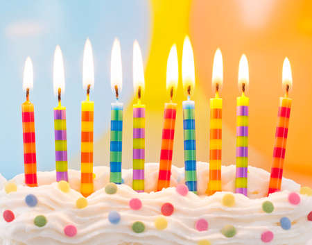 Birthday candles on colorful background