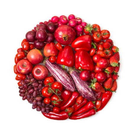 Circle of red fruits and vegetables isolated on a white background