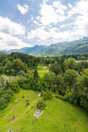 Landscape of Slovenia mountains in Triglav national park. Look from the church tower near Bohinj lake. Small garden near church.