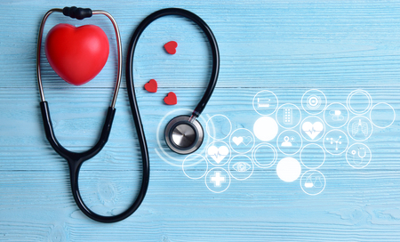 Photo pour Red hearts with stethoscope on blue wooden background. Copy space. Valentines day. - image libre de droit