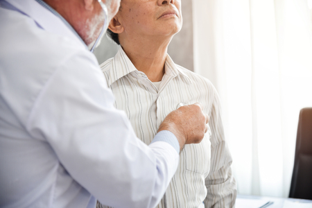 Photo pour Senior Doctor is examining An Asian patient with stethoscope. Medical and health concepts. Lung, Cancer, pneumonia. - image libre de droit