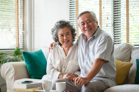 Foto de Portrait of Retirement Senior Couple enjoying life. Looking to camera. - Imagen libre de derechos