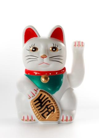 White lucky cat, Maneki-neko, on white background