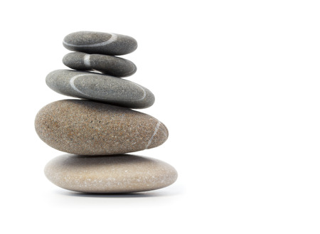Stack of balanced stones against white background