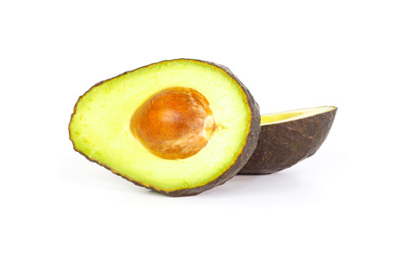 Two halves of avocados with smooth creamy flesh against a white background