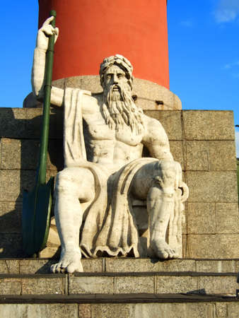 Photo of a statue of the master of water on a throne.