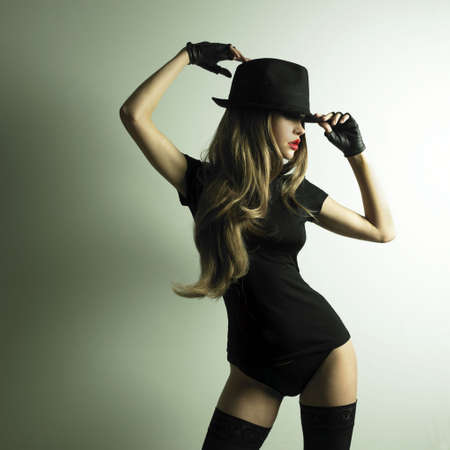 Portrait of beautiful dancing girl in hat