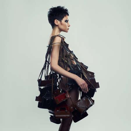 Foto de Beautiful girl in an unusual dress of the old photo cases - Imagen libre de derechos