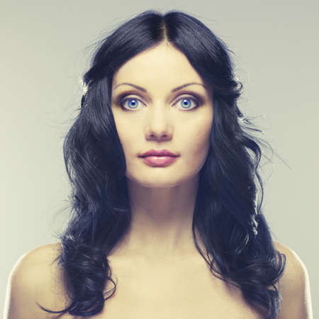 Photo of young beautiful woman with blue eyes