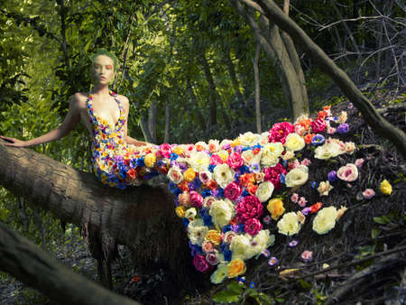 Foto de Blooming gorgeous lady in a dress of flowers in the rainforest - Imagen libre de derechos