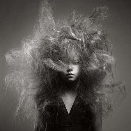 Foto de Black and white portrait of a young girl with a volume fashionable hairstyle - Imagen libre de derechos