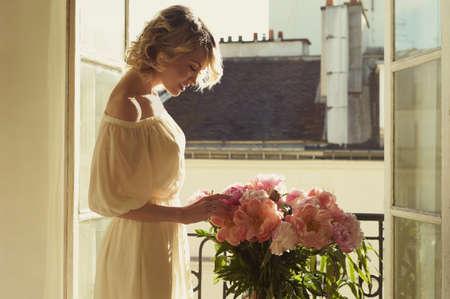 Fashion art portrait of beautiful blonde at the window