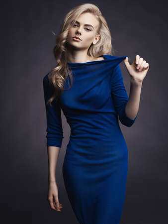Studio fashion photo of elegant beautiful lady in blue dress