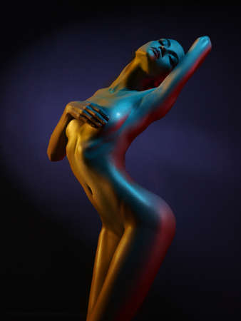 Photo pour fashion art photo of elegant nude model in the light colored spotlights - image libre de droit